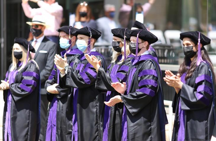 JD graduates clapping