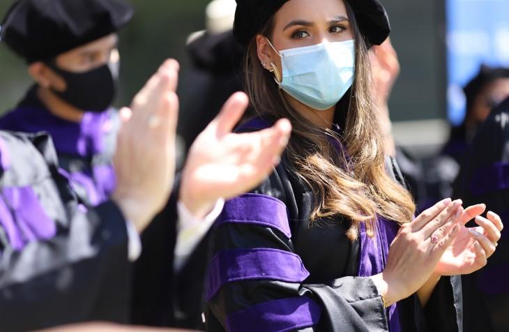 LLM graduates clapping