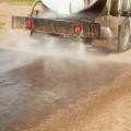 tanker truck spraying dust supression